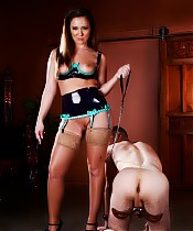 Mistress Maddy O'Reilly is going to take out her bad mood on her humbled slave's balls.