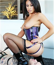 Mistress Tangent shows off her incredible body in purple latex, then prepares to use a slave for her pleasure.