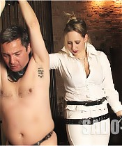 Riding Mistress whips a slave until he is broken
