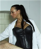Two dominant female doctors, dressed in leather under their coats, abuse a slave.