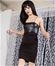 Brunette mistress is making two savoring slaves to lick her shoes