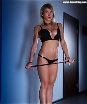 Inked domme armed with a whip buries slave's face between her soft buttocks